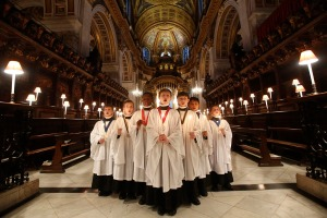 Choristers of St Paul's Cathedral sing Christmas carols during a photocall inside the Cathedral in central London