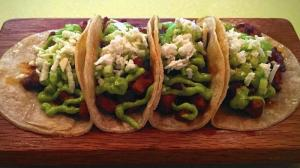 The Barriga de Puerco taco, a taco made with slow-roasted pork belly, adobo, salsa verde cruda, cucumber, and queso fresco is a dish not to be missed at Bein Trucha on State Street in Geneva. (Beth Casey, Beacon-News)