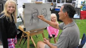 Artist Robert R. Williams creates a portrait of residents at the Lubeznik Art Festival
