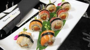 Known best for their sushi rolls, Shakou Sushi is the new hot spot of Main Street in St. Charles. Pictured here is the rainbow roll, spicy tuna and cucumber topped with assorted fish fillets and kaiware.